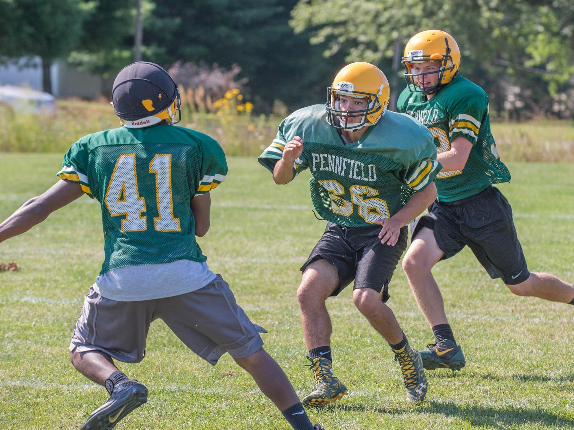 First day of practice with full pad for Pennfield High School football team.