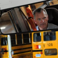 School Bus Inc. safety director Kevin Hansen demonstrates safety features on a school bus on Aug. 31. The Sioux Falls School District and School Bus Inc. are teaming up to educate students and parents on school bus safety.