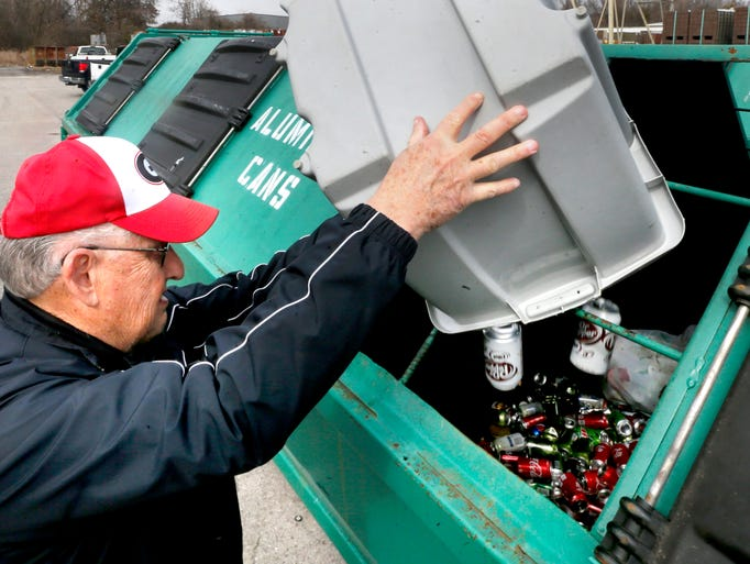 Robert Lutte recycles aluminum cans after first collecting