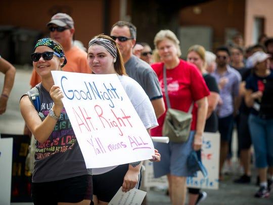 "Ilana Blumenthal holds a sign saying ""Good Night, Alt"