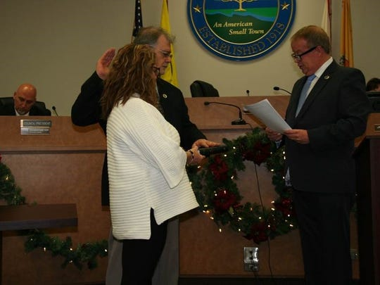 Bloomingdale Councilman Anthony Costa is sworn in by Mayor Jon Dunleavy. His wife Donna holds the Bible.