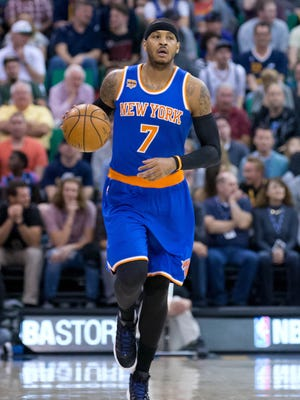 """When Knicks forward Carmelo Anthony (7), pictured during Wednesday night's loss in Utah, was questioned about the team returning its focus to the triangle offense and next year, Anthony said: """"I don't even want to talk about that or next training camp."""""""