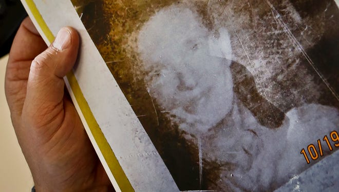 This Tuesday, Oct. 31, 2017, photo shows a picture of Flora Stevens from a 1975 job application used to help solve a missing persons case in Monticello, N.Y. Stevens, who disappeared from upstate New York after being dropped off for a doctor's appointment 42 years ago, has been found suffering from dementia and living in an assisted-living facility near Boston, Mass., authorities said. (AP Photo/Seth Wenig)
