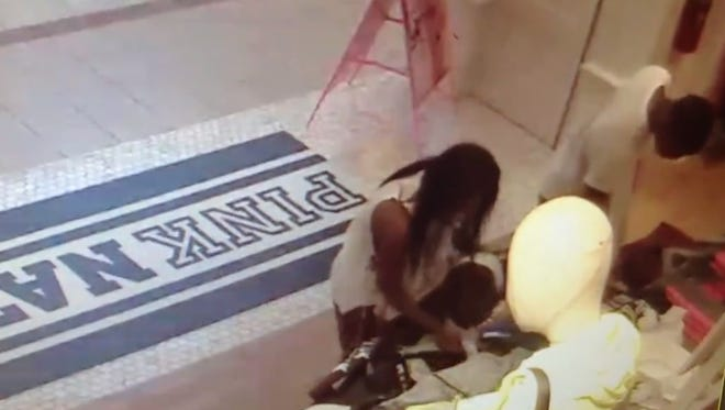Surveillance footage released from Toms River police shows a man and woman shoplifting from Pink, a subdivision of Victoria's Secret.