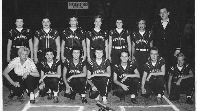 "Pictured is the team that brought Kewanee the first of five Illinois Amateur Softball Association championships.  Front row, from left: Grace Larson (business manager), Martha Gwinn, Elaine Kuster, Gerry Hammerstrand, Janet Holmes, Marilyn ""Cookie"" Matson and Karen Lawrence.  Back row: Judy Wickham, Nancy Huibregtse, Frances Olson, Ellie Erickson, Kathy Passalacquel, Dot Larson and Wilbur Osborne (manager)."