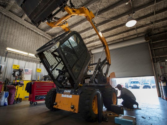 Bob Olson, senior mechanic with the City of Cape Coral, works on a skid steer at the city's fleet management garage  Wednesday, April 18, 2018.