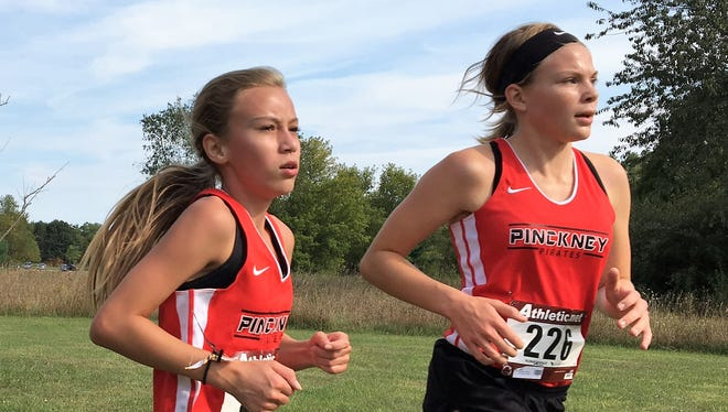 Vivi Eddings (left) and Noelle Adriaens of Pinckney have the two fastest girls' cross country times in Livingston County this season.