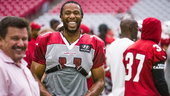 Arizona Cardinals wide receiver Larry Fitzgerald and Cardinals President Michael Bidwill, left, share a laugh on the sidelines at practice at University of Phoenix Stadium, Wednesday, August 23, 2017.