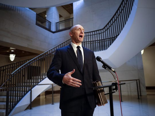 "FILE - In a Nov. 2, 2017 file photo, Carter Page, a foreign policy adviser to Donald Trump's 2016 presidential campaign, speaks with reporters following a day of questions from the House Intelligence Committee, on Capitol Hill in Washington. President Donald Trump claimed Sunday, July 22, 2018, that newly released documents relating to the wiretapping of his onetime campaign adviser Carter Page ""confirm with little doubt"" that intelligence agencies misled the courts that approved the warrant. But lawmakers from both parties say the documents don't show wrongdoing.(AP Photo/J. Scott Applewhite, File)"