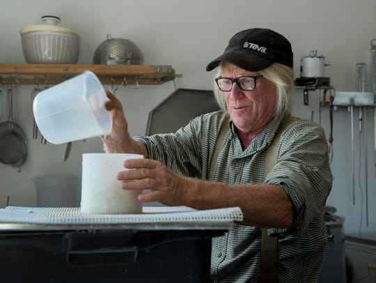 Mesa Farm owner Randy Ramsley separates curds and whey