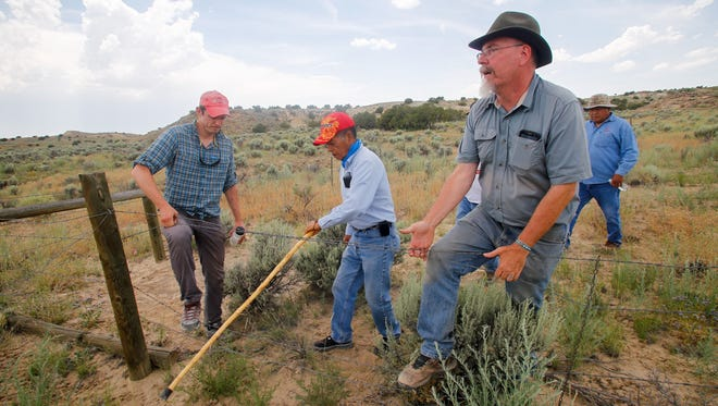 Paul Reed, right, a preservation archaeologist with Archaeology Southwest, leads a tour June 23 at Pierre's Ruins north of Chaco Culture National Historical Park.