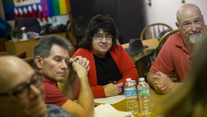Community member Joe Rivas, Identity Inc. board member James Penrod, Identity Inc. President Judy Palier and community member Mark Lewis attend a bi-weekly community meeting Wednesday at the organization's community center in downtown Farmington.