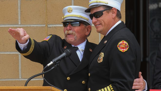 San Juan County District 7 Chief Rodney Taylor, left, and San Juan County Fire Chief Craig Daugherty celebrate the opening of a new fire station in Cedar Point Wednesday.