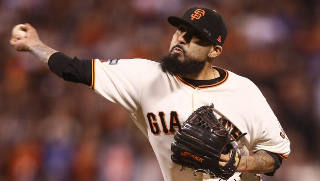 Sergio Romo of the San Francisco Giants delivers a pitch in the ninth inning against the Chicago Cubs during Game Three of their National League Division Series against the Chicago Cubs at AT&T Park on October 10, 2016 in San Francisco, California.  (Photo by Ezra Shaw/Getty Images)