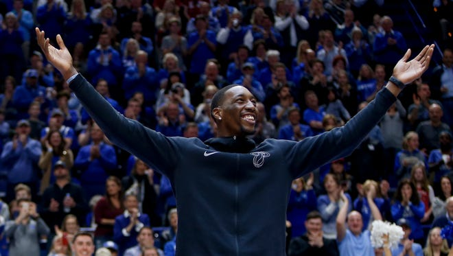 "Former Kentucky Wildcats and current Miami Heat rookie Bam Adebayo does the ""Y ""during the second half against the Alabama Crimson Tide at Rupp Arena in Lexington, KY., on February 17, 2018."