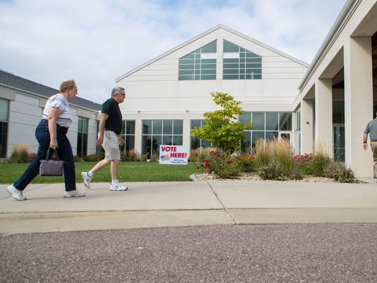 Sioux Falls residents walk into Gloria Dei Lutheran