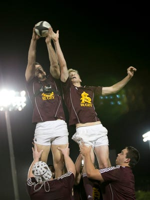 ASU's Ryan Koewler (left) and Andrew Burke jump for the ball during an ASU rugby team practice on  April 3, 2014.