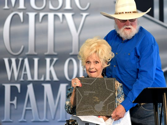 Brenda Lee celebrates with Charlie Daniels after Lee was inducted into the Music City Walk of Fame in Nashville on Tuesday, Aug. 21, 2018.