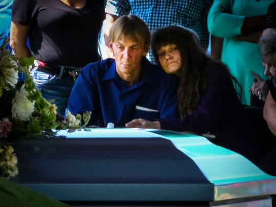 Chris Brewer and Brande Brewer attend the graveside