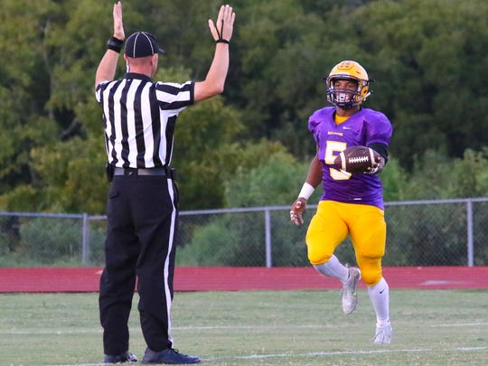 Smyrna's Casey Perkins scores an early touchdown during Friday's game.