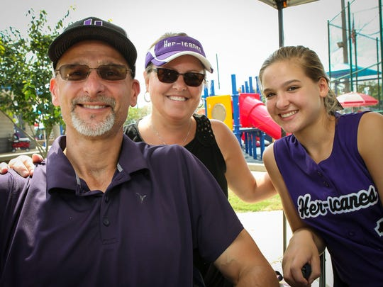 McMinnville's Tim Jennigs, left poses with his wife, Debbie (center) and daughter, Samantha, at the Play 4 Tay Softball Tournament.