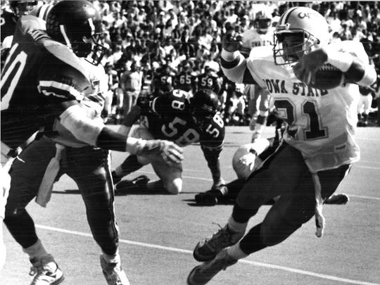 Cyclone Blaise Bryant, #21, moves past a Kansas defender during the team's game on Oct. 7, 1989.
