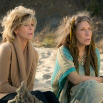 """This photo provided by Netflix shows Jane Fonda, left, and Lily Tomlin in the Netflix Original Series """"Grace and Frankie,"""" premiering on Friday. (Melissa Moseley/Netflix via AP)"""
