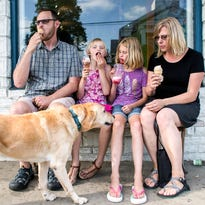 Matt, Nora, Ruby and Sarah Leggat enjoy ice cream from The Hop in West Asheville with family dog, Bo, last week. The family rents in West Asheville but plans to buy a house in East Asheville, where prices are more affordable.