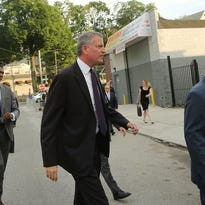 New York Mayor Bill de Blasio enters an interfaith prayer service at Mount Sinai United Christian Church in New York on July 14, 2015.