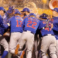 The Chicago Cubs celebrate after defeating the Pittsburgh Pirates to win the National League Wild Card game at PNC Park on October 7, 2015 in Pittsburgh, Pennsylvania. The Chicago Cubs defeated the Pittsburgh Pirates with a score of 4 to 0.  (Photo by Justin K. Aller/Getty Images)