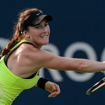 Madison Brengle returns a shot to Anett Kontaveit during the third round of the U.S. Open on Friday.