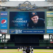 A moment of silence is held before the Reds-Brewers game Sunday in remembrance after the passing of Jose Fernandez of the Miami Marlins.