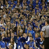 Kentucky fans cheer for their team during the second half of play against Florida at Rupp Arena in Lexington, Ky. March 7, 2015.
