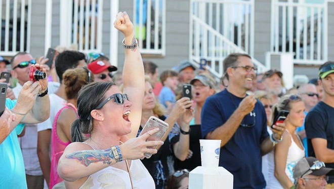 Jillian Shields cheers as her fathers boat the Sea Flame has just weighed in a 39 pound tuna to become the new leader. During the 43rd Annual White Marlin Open on the last day of the tournament. Megan Raymond Photo