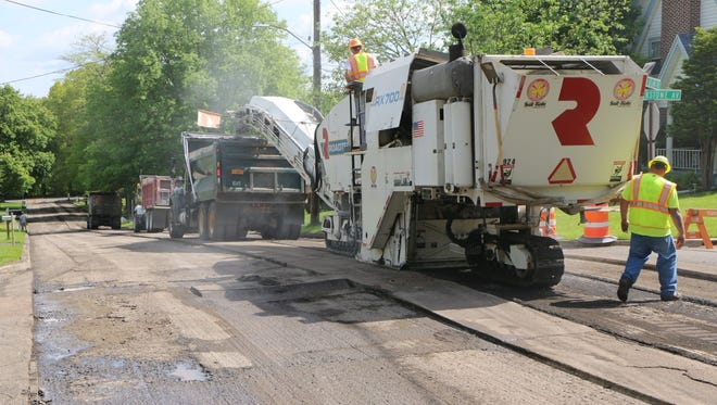 A road crew works on a paving project on Jutland Avenue in the City of Binghamton on Friday, May 19, 2017.