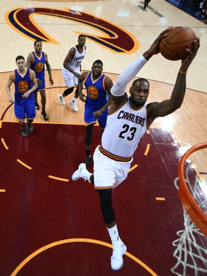 Cleveland Cavaliers forward LeBron James (23) dunks against the Golden State Warriors during the second half of Game 6 of basketball's NBA Finals in Cleveland, Friday, June 17, 2016. Cleveland won 115-101. (Ronald Martinez//Pool Photo via AP)