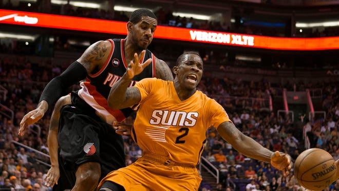 Phoenix Suns guard Eric Bledsoe has the ball stolen from him by Portland center LeMarcus Aldridge during a Suns home game against the Portland Trailblazers at US Airways Center March 27, 2015 in Phoenix, Arizona.