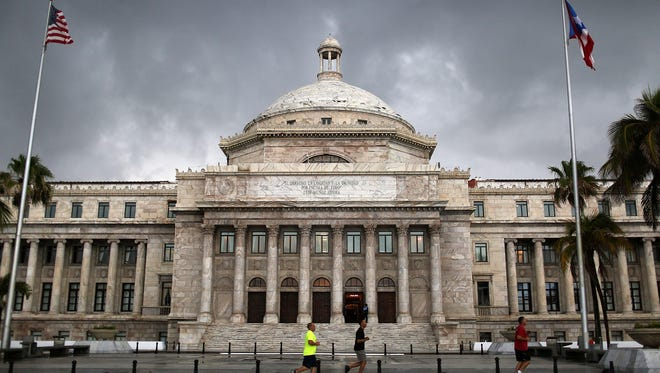 """The Puerto Rican Capitol building. Puerto Rican bonds have  """"triple-tax-free"""" status — exempt from federal, state and local income taxes."""