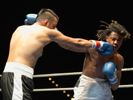 Fes Batista, left, lands a flurry of blows to opponent,