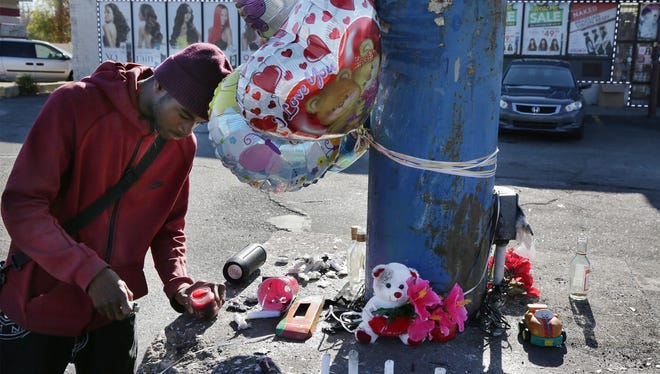 Curtis Robertson, 21 of Detroit visits the site of the fatal car crash that took the life of his friends Sunday morning on 7 mile and Stotter in Detroit on Monday, Nov. 16, 2015..