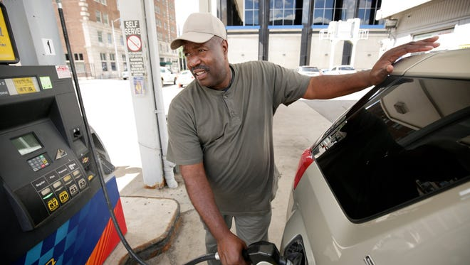 John Turnner, 50, of Detroit fills his SUV at the Sunoco gas station on First and W. Fort Street in Detroit on Friday, July 31, 2015.