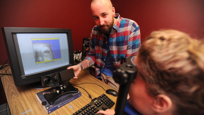 NMSU psychology professor Michael Hout and graduate assistant Arryn Robbins demonstrate how they use an eye-tracker system to conduct experiments that examine eye movements and pupillometry.