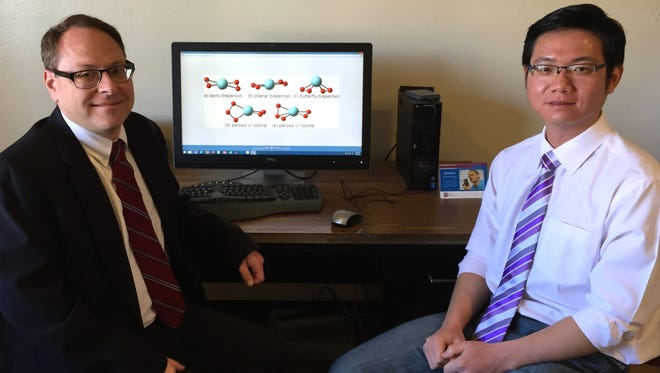 New Mexico State University Chemical and Materials Engineering Assistant Professor Thomas Manz, left, and Bo Yang, a Ph.D. student, have developed a new more-efficient selective oxidation catalyst after nearly four years and more than one million computational hours.