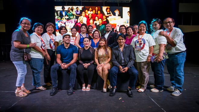 Officers of the Filipino Community of Guam and event volunteers take a group photo with the visiting celebrities.