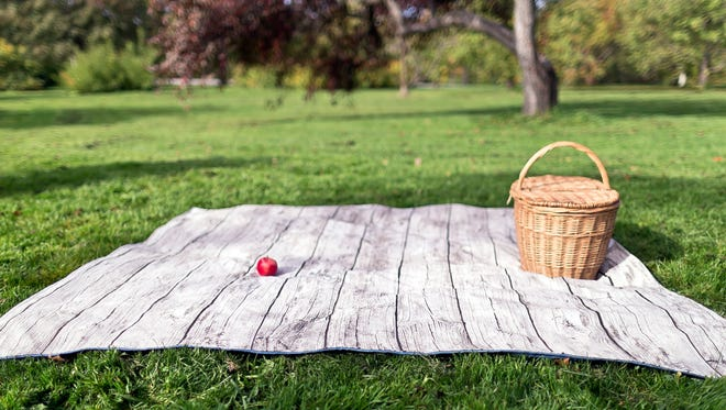 Extra large roll up picnic blanket in gray woodgrain for $170.