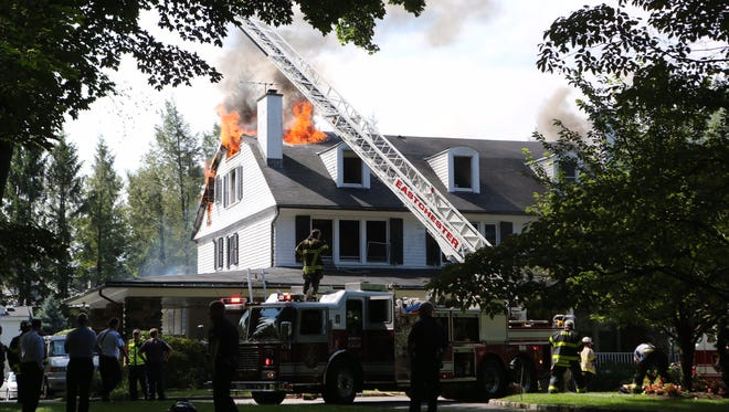 Flames shoot out of a Bronxville home on Elm Rock Road on Aug. 2, 2016.
