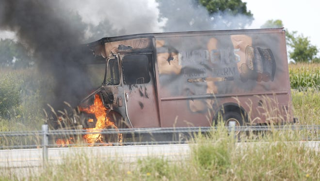 A Pieper's Fruit Farm truck on fire shut down southbound traffic on I-41 in Fond du Lac Thursday morning.