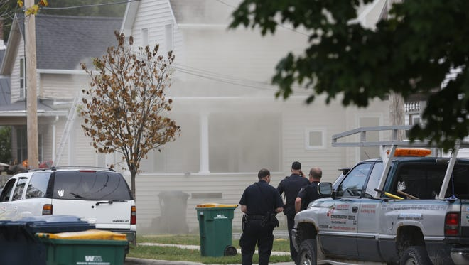 Emergency crews respond to the scene of a house fire Friday, August  26, 2016, on Central Avenue in Fond du Lac. Doug Raflik/USA TODAY NETWORK-Wisconsin