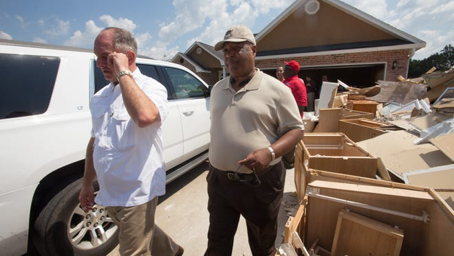 Governor John Bel Edwards tours flood damage with State Sen. Gerald Boudreaux  in the Derby Heights subdivision of Lafayette September 1, 2016.