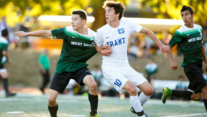 West Salem's Christian Gaytan (3) competes for the ball with Grant's Solas Wall-Johnson (10) in a game on Tuesday, Sept. 13, 2016, in Portland, Ore. The West Salem Titans tied 1-1 with Grant.